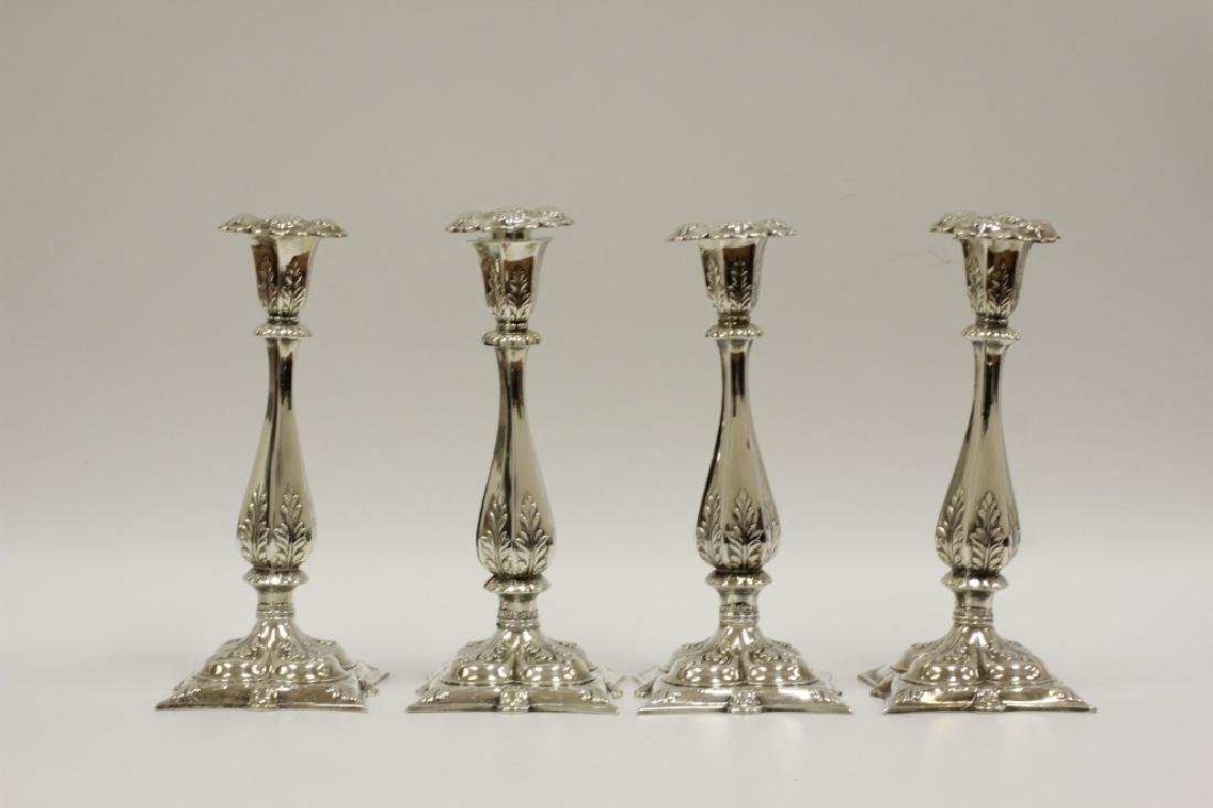 4 Sterling Silver Candle Holders. By Howard & Co.