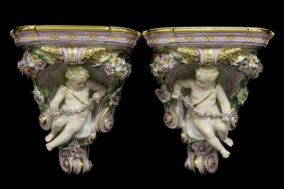 Pair of Early 20thc Figural Porcelain Shelves