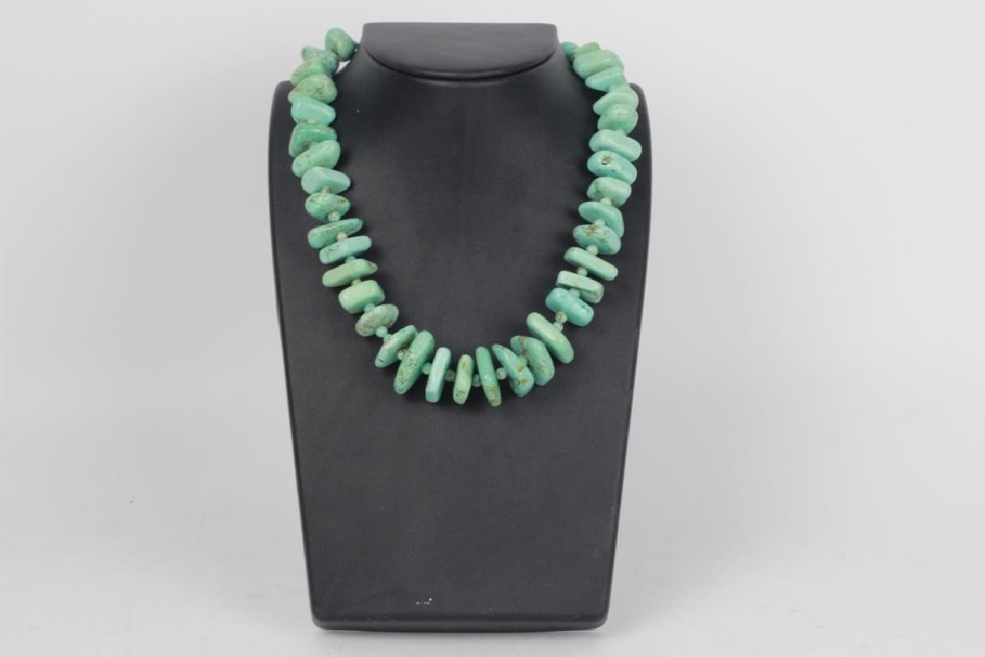 Turquoise necklace with silver mounts