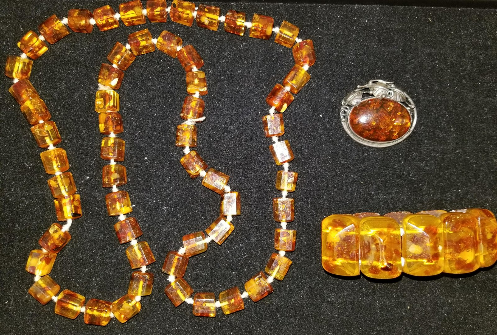 3 Pieces of Amber Jewelry, 1 with Silver mounts