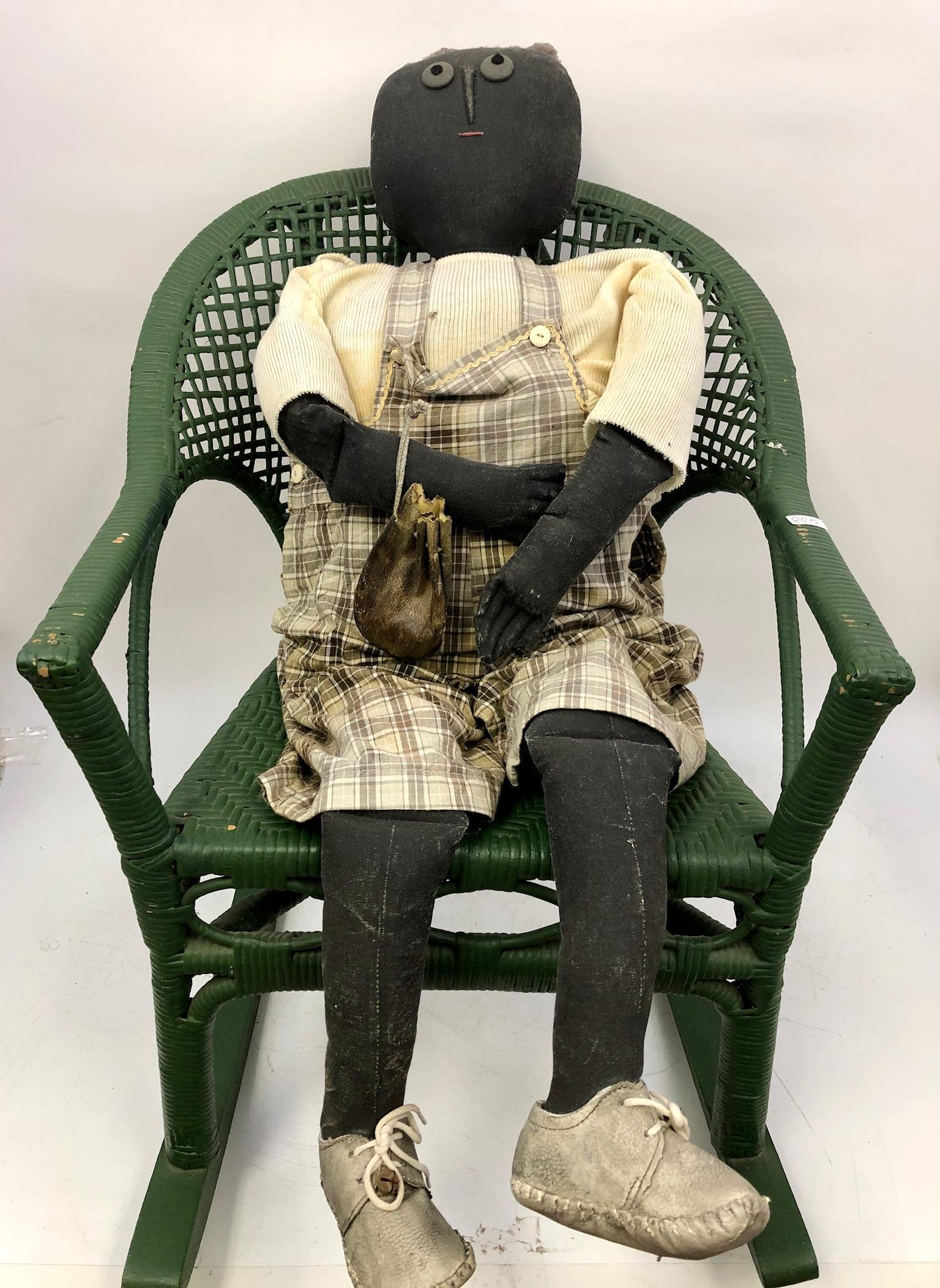 Antique Life Size Doll on a Wicker Rocking Chair