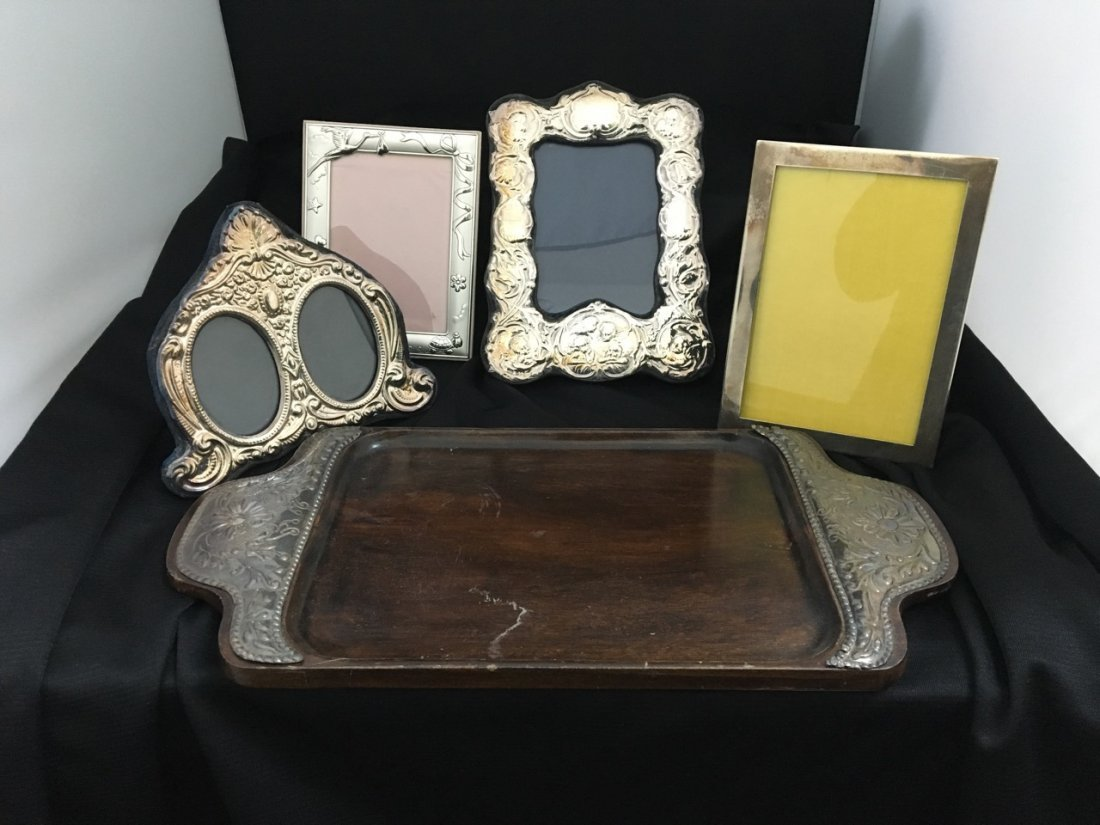 Four Silver Frames, One Wood and Silver Tray
