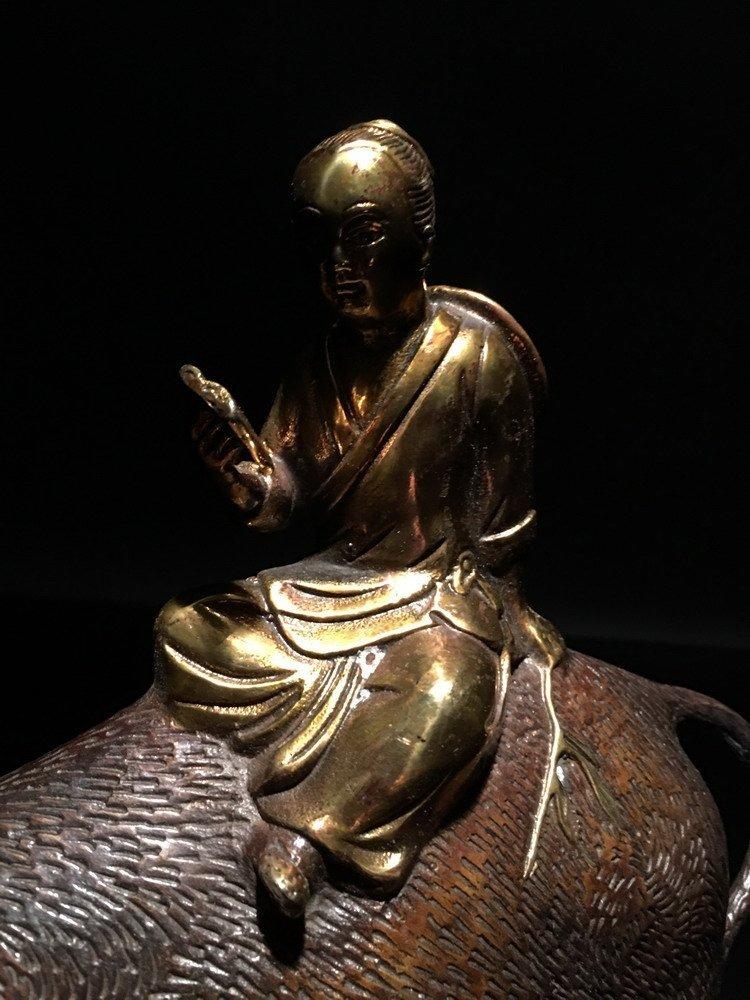 A Bronze Child Riding on a Bufflo - 4