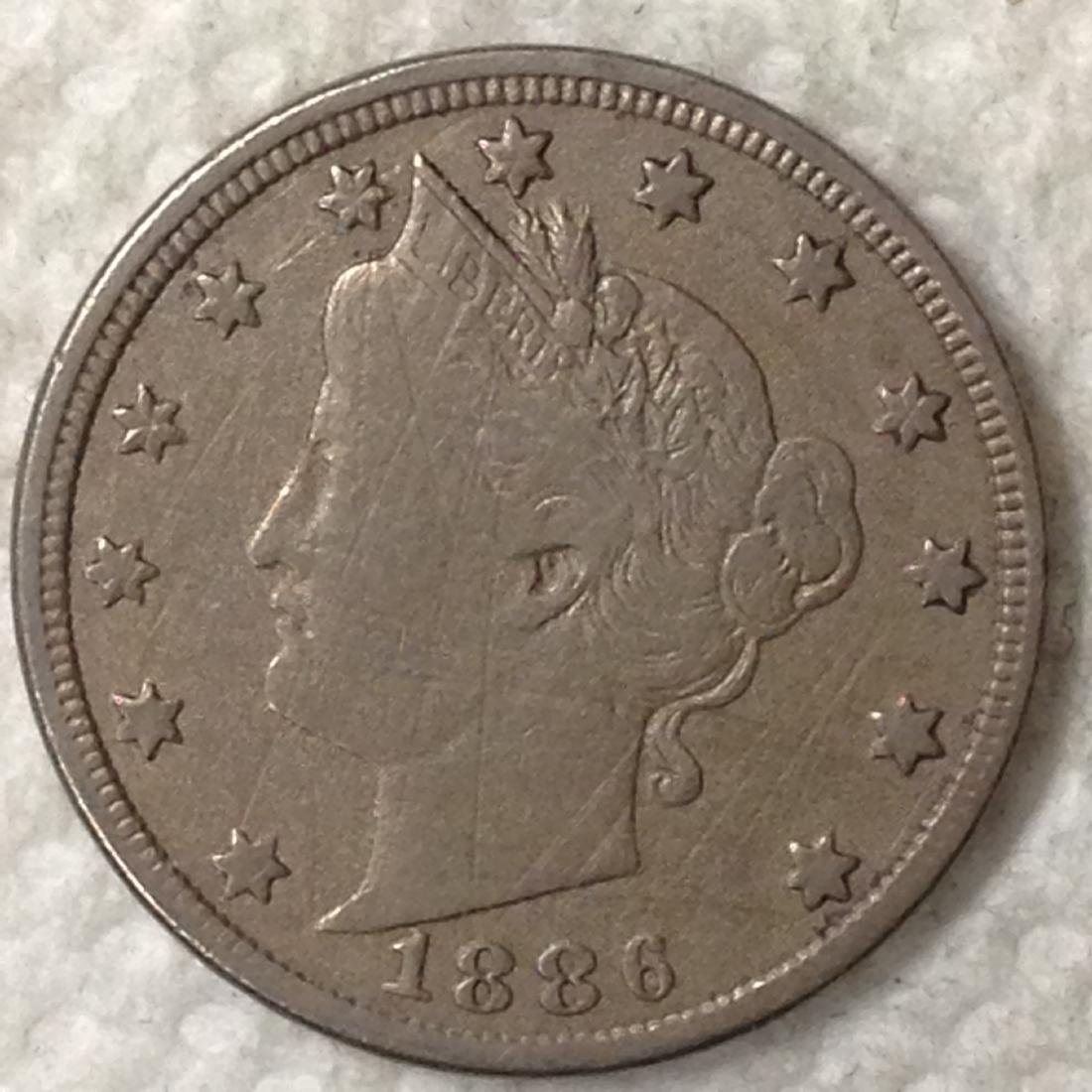 1886 5C VF DETAIL SHARP DETAIL BUT SCRATCHES. KEY DATE