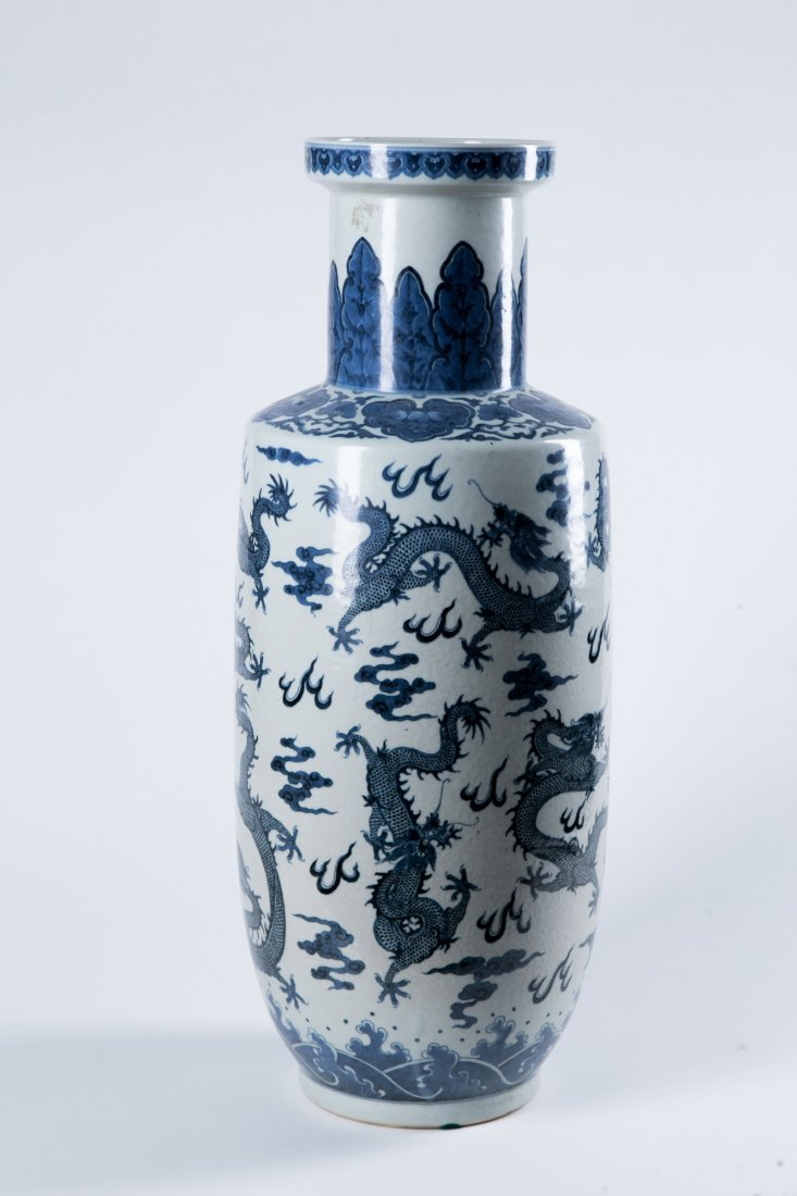 A BLUE AND WHITE 'DRAGON' ROULEAU VASE, QING DYNAY