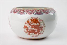 A IRON-RED 'DRAGON' WASHER WITH QING GUANGXU MARK AND