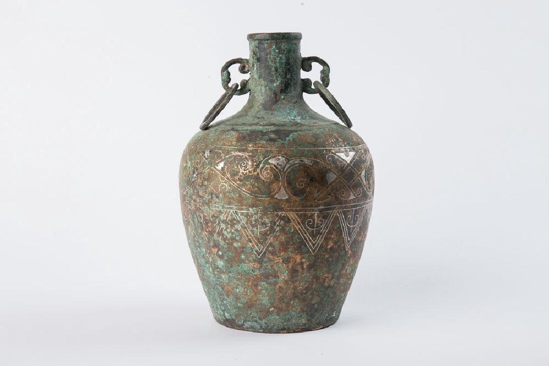 AN ARCHAIC BRONZE RITUAL VASE WITH GOLD AND SILVER