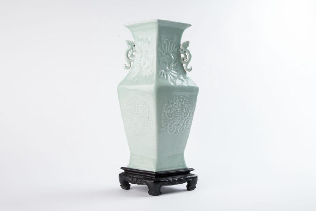 A CELADON-GLAZED HANDLED VASE WITH QING QIANLONG MARK