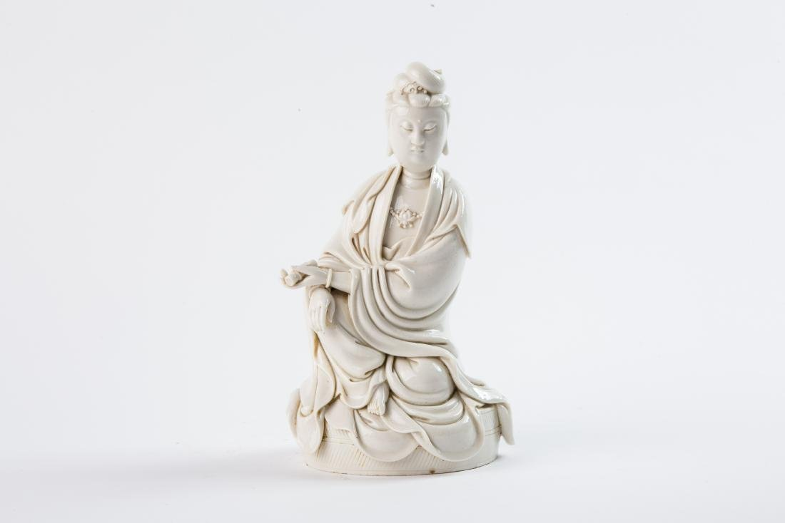 A DEHUA FIGURE OF GUANYIN BY HE CHAOZONG, EARLY QING