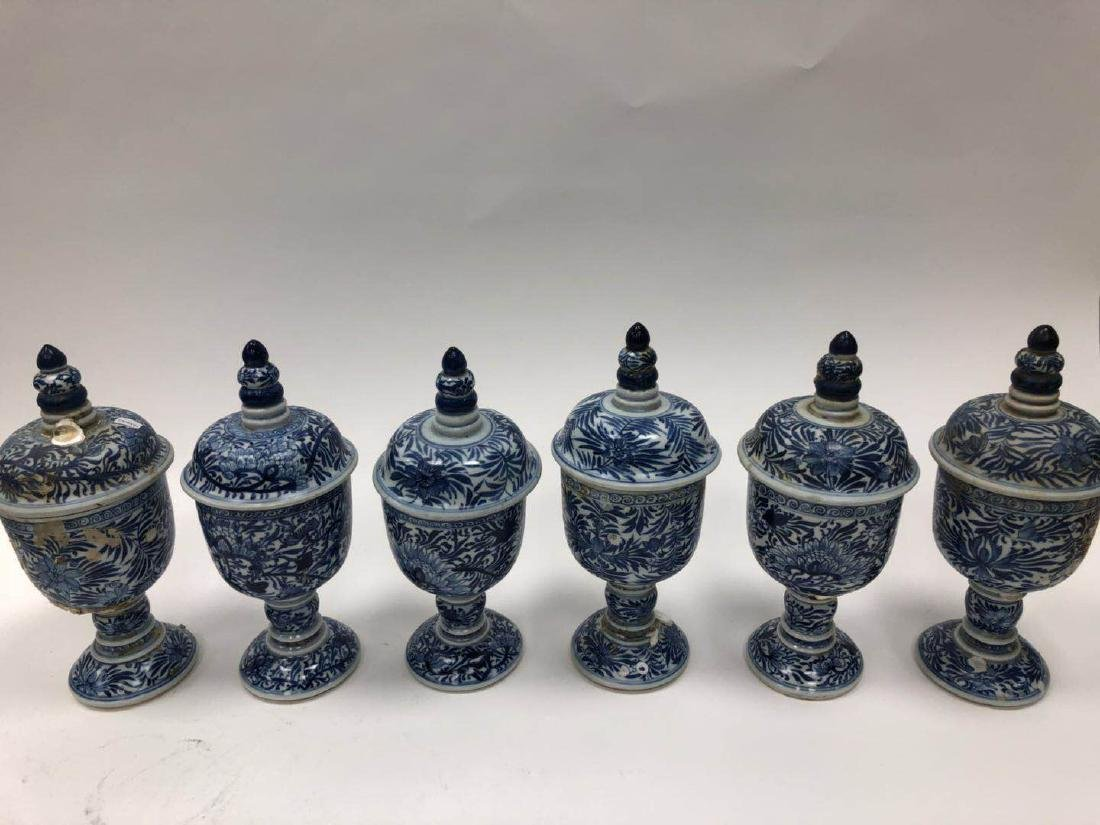 SIX BLUE AND WHITE 'FLOWER ' STEMCUPS, KANGXI PERIOD