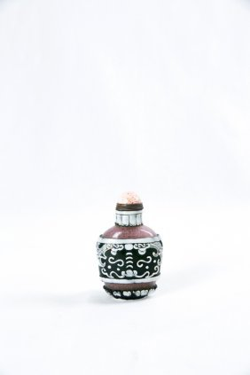 A Chinese Qing Double Color Carved Snuff Bottle
