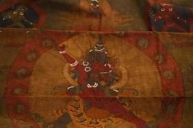 A Tibetan Qing Kesi Silk Tangka