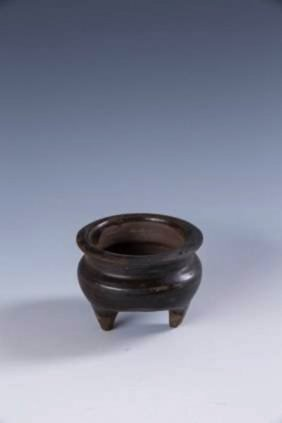 A Chinese Black Glazed Tripod Censer