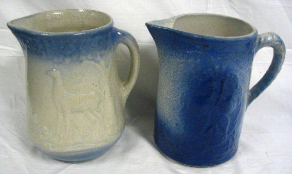TWO BLUE & WHITE STONEWARE PITCHERS