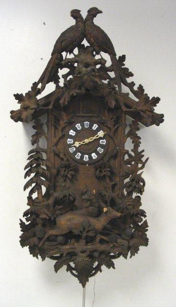 LARGE ELABORATELY CARVED ANTIQUE WALNUT CUCKOO CLOCK