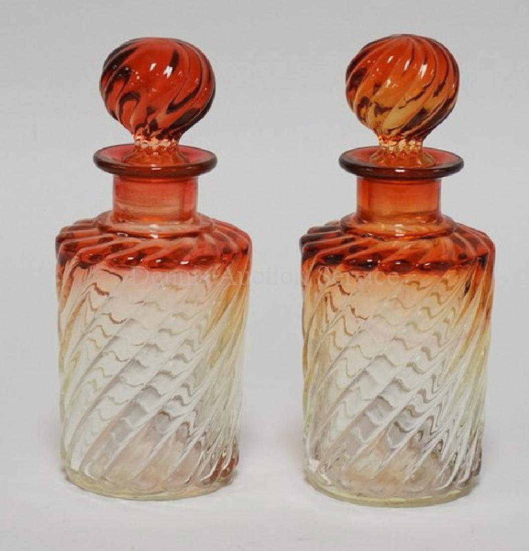 PAIR OF BACCARAT RUBINA SWIRL COLOGNE BOTTLES WITH