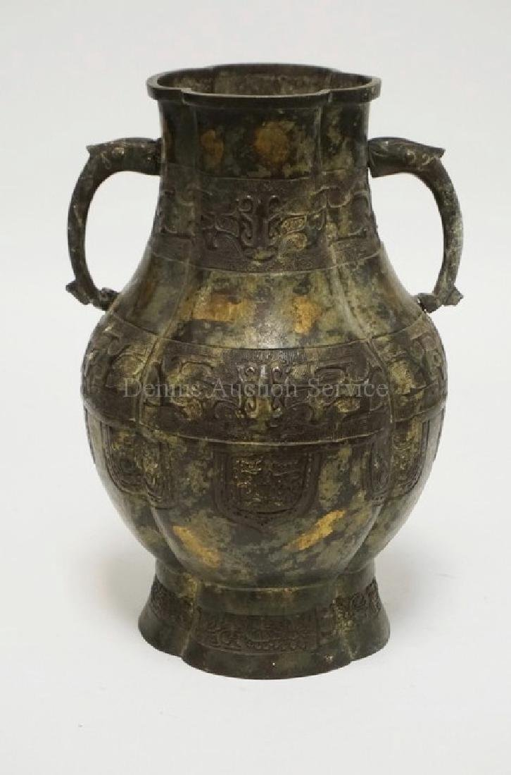 ASIAN METAL URN WITH SERPENT HANDLES. 11 3/4 IN H. ONE
