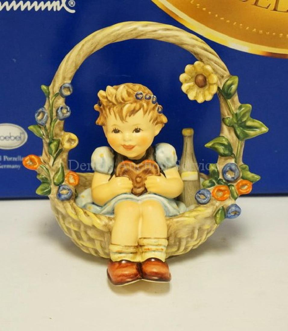 HUMMEL #618 *BASKET OF GIFTS* FIGURE. 5 1/8 INCHES