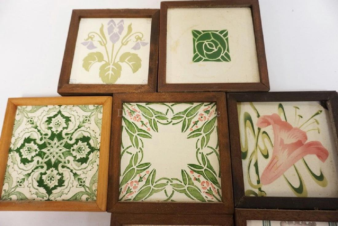 LOT OF 9 ANTIQUE TILES. MOSTLY FLORAL DECORATED. ONE - 3
