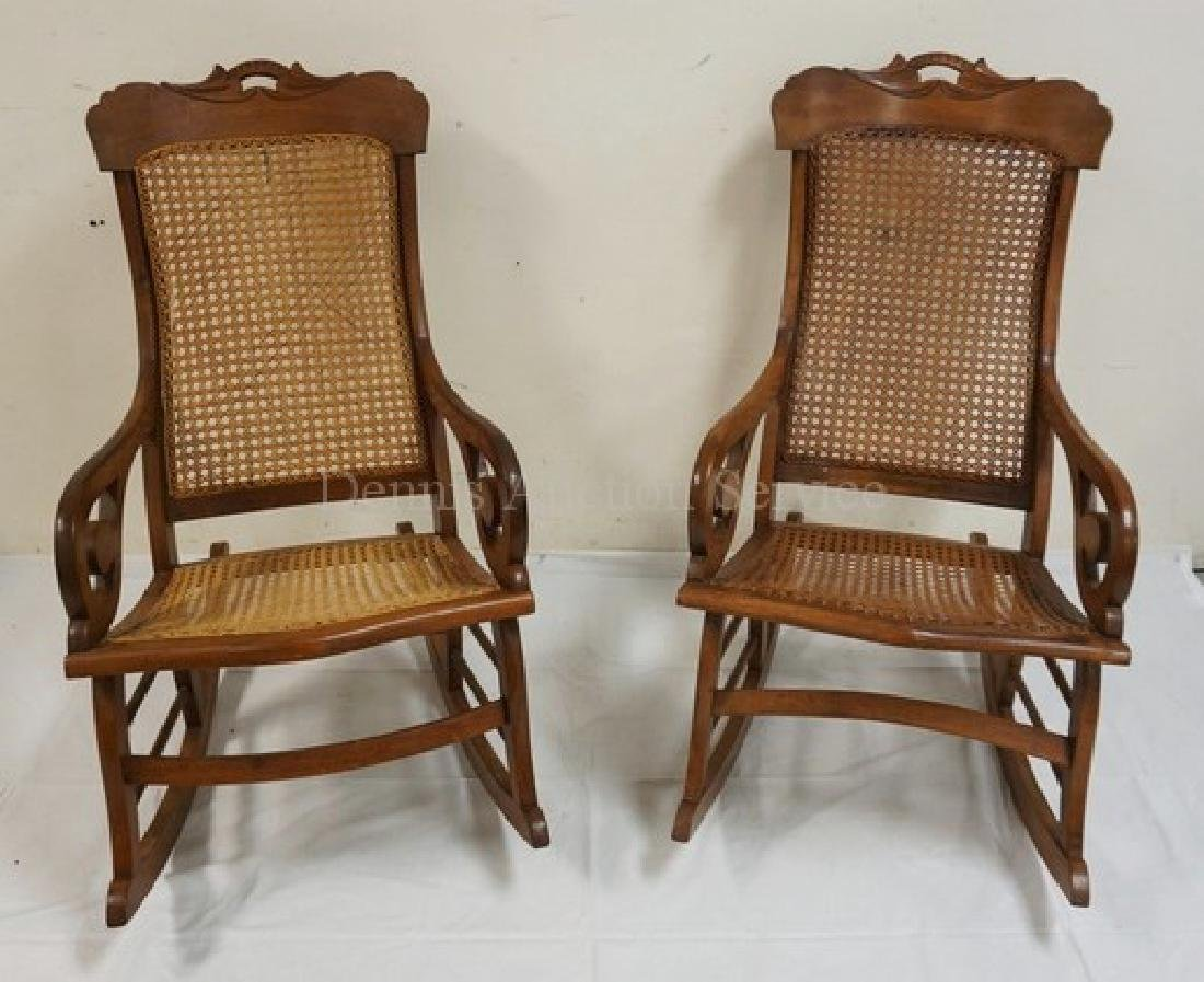 PAIR OF WALNUT ROCKING CHAIRS WITH CANED SEATS AND