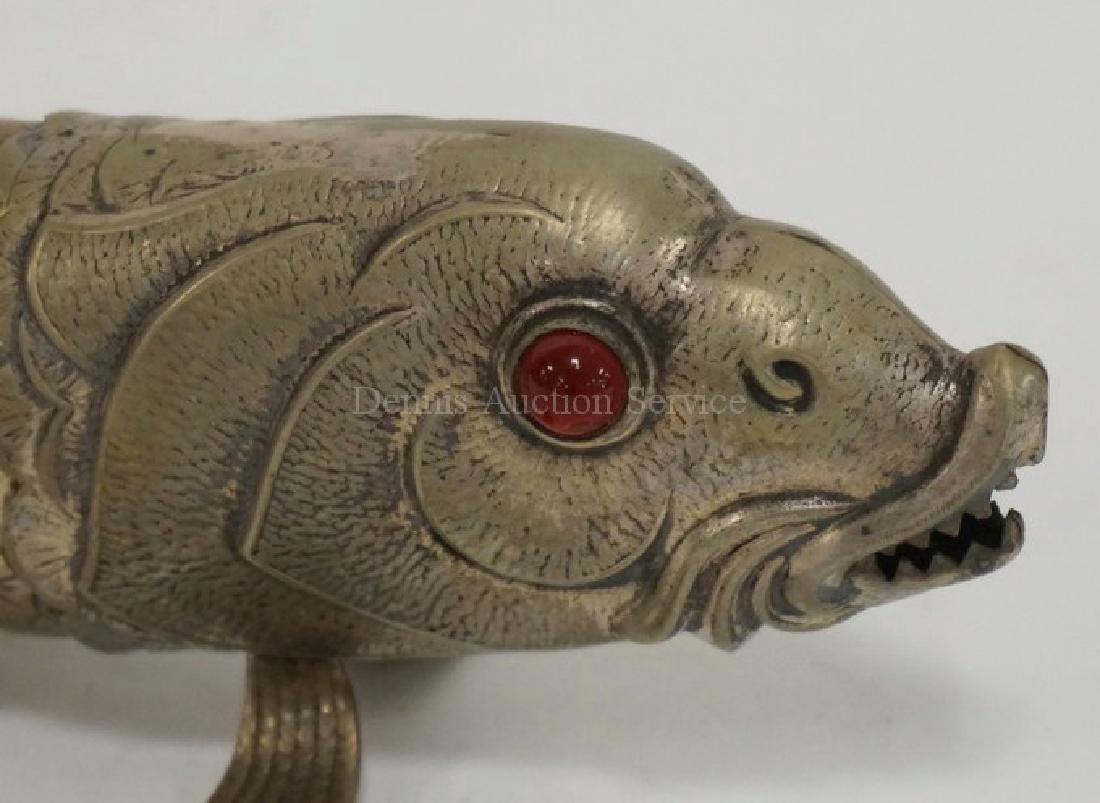 ARTICULATED METAL FISH WITH GLASS EYES. 10 3/4 INCHES - 2