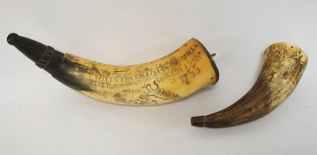 LOT OF 2 POWDER HORNS. ONE WITH SCRIMSHAW DECORATION