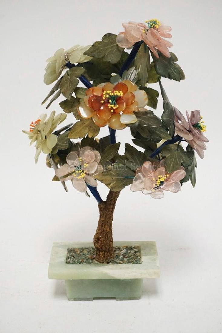 ASIAN CARVED STONE SCULPTURE OF A FLOWERING TREE IN A