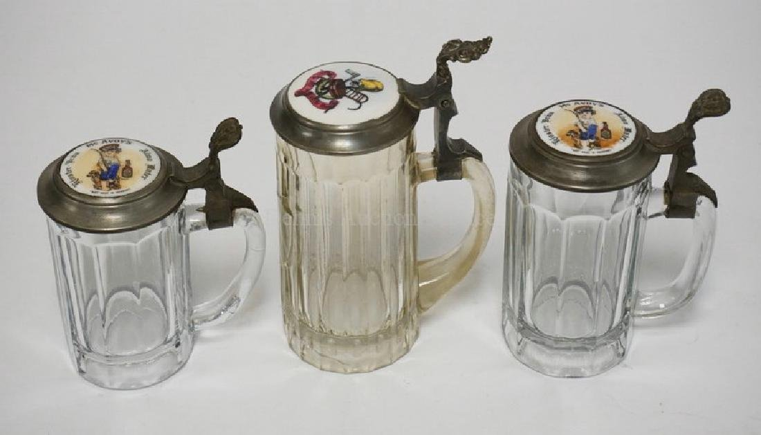 LOT OF 3 GLASS STEINS. EACH WITH DECORATED PORCELAIN
