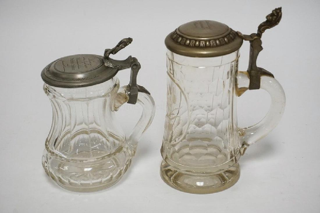LOT OF 2 GERMAN CUT GLASS STEINS WITH ENGRAVED PEWTER