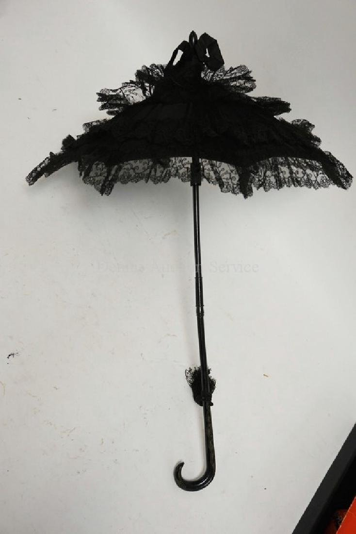 EARLY HAND WORKED LACE PARASOL WITH A CARVED HANDLE,
