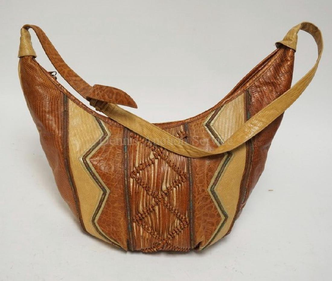 SHARIF LEATHER PURSE WITH VARYING TEXTURES. 18 INCHES