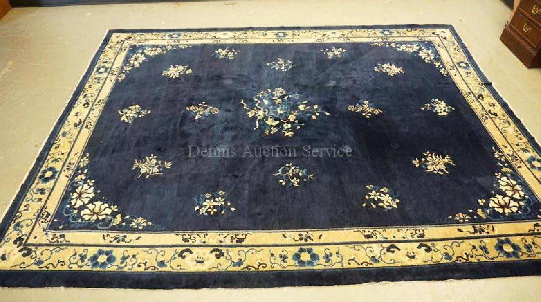 ROOM SIZE CHINESE RUG IN BLUE AND CREAM. 9 FT 3 INCHES