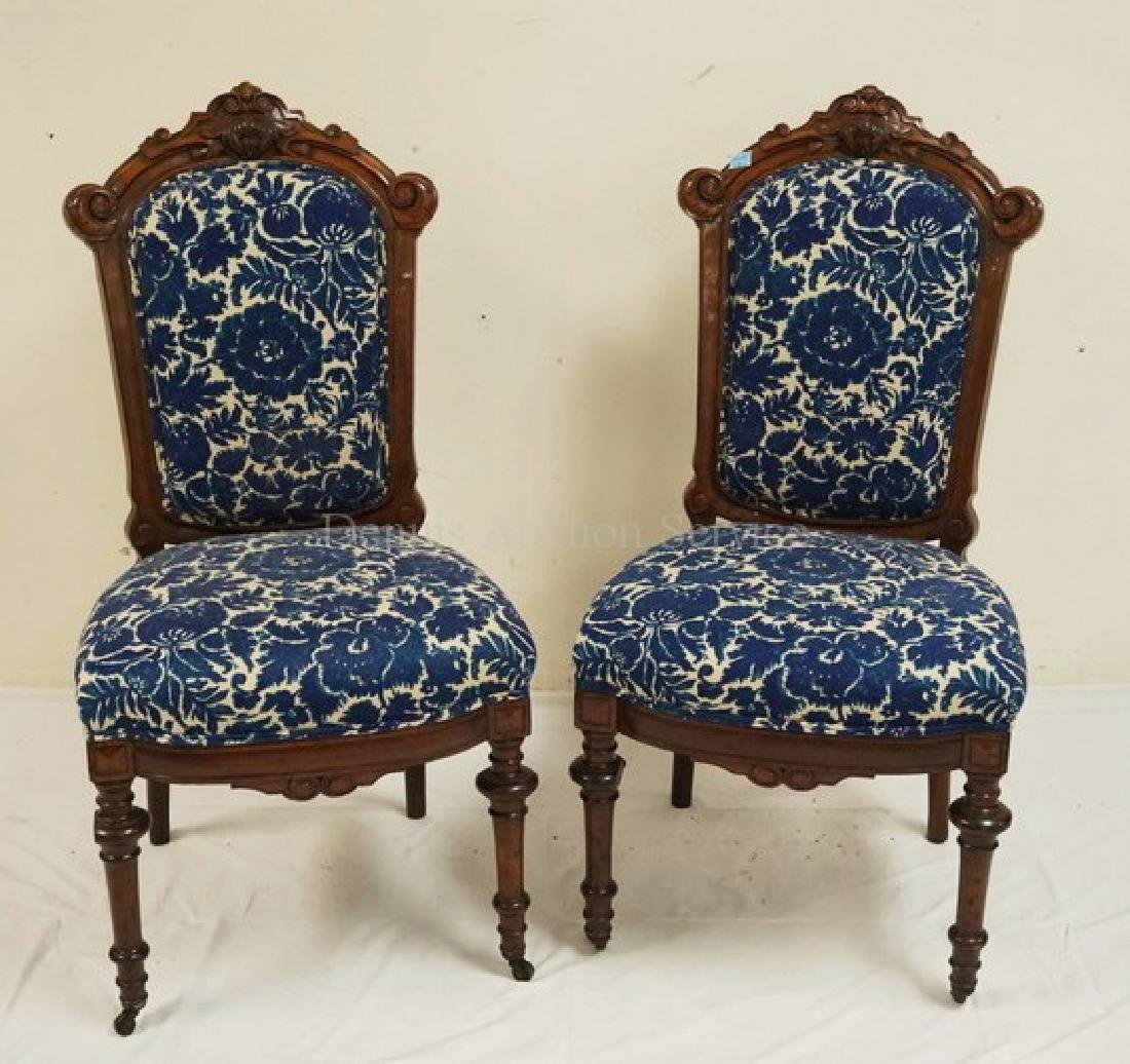 PAIR OF VICTORIAN CARVED WALNUT SIDE CHAIRS. 39 3/4