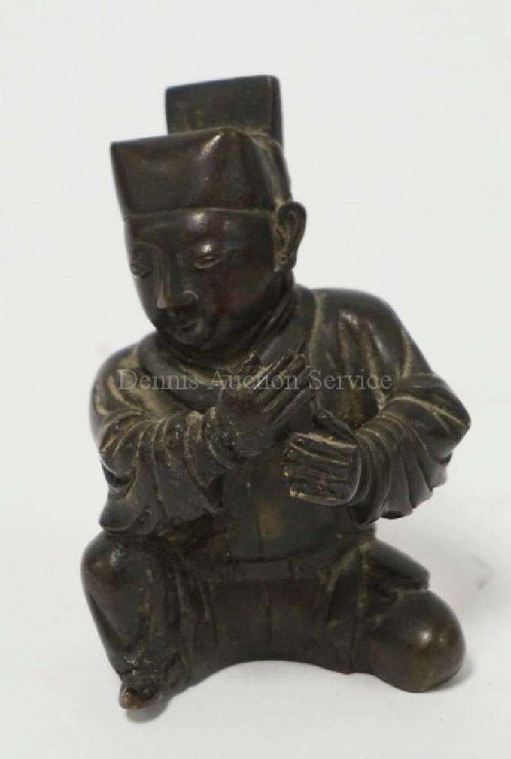 ASIAN BRONZE FIGURE OF A SEATED MAN. 3 3/4 INCHES HIGH.