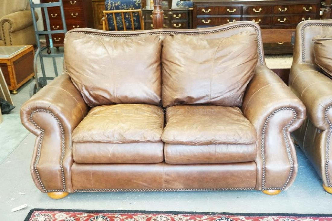 LEATHER LOVESEAT. HAS WEAR & FADING.