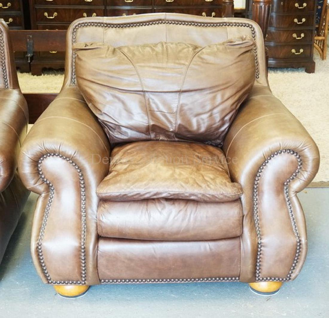 LEATHER LOUNGE CHAIR. HAS SOME WEAR.