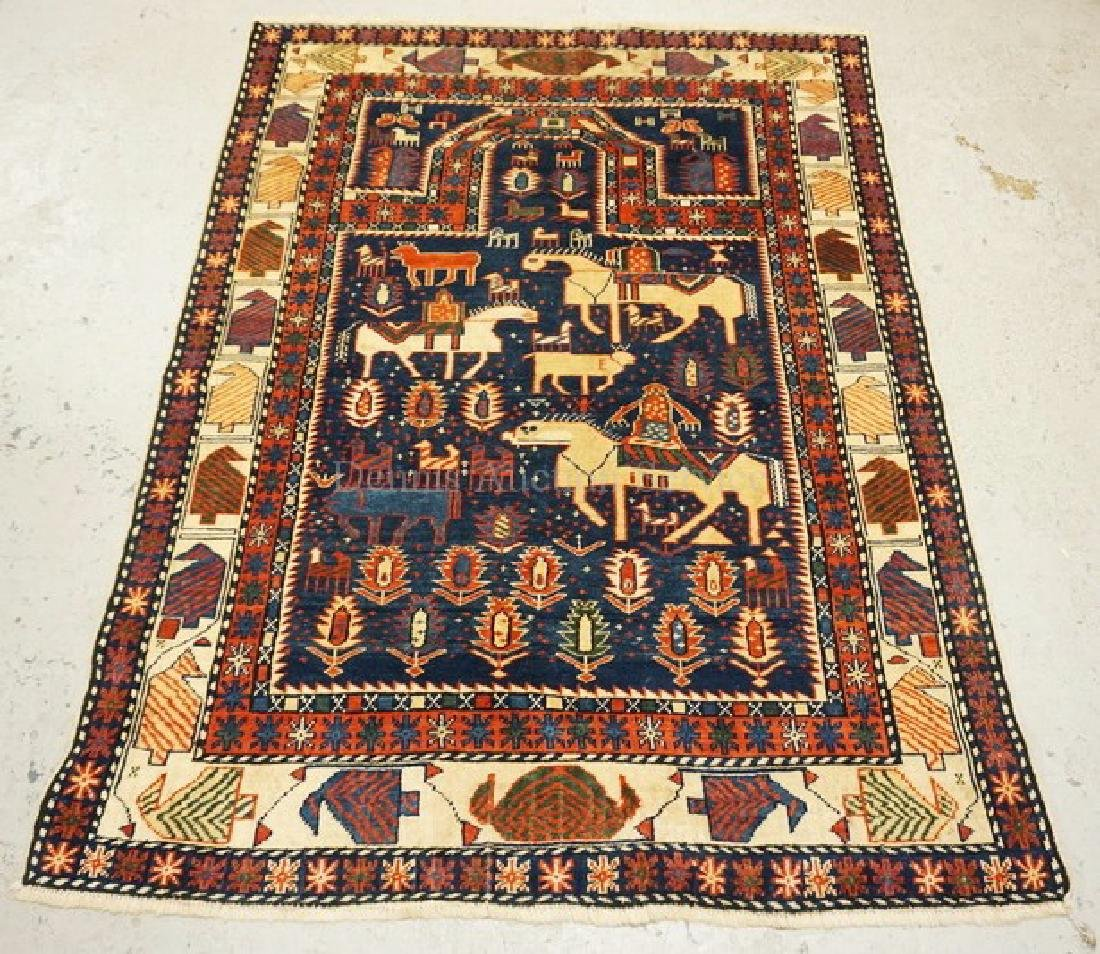 HAND WOVEN ORIENTAL RUG MEASURING 5 FT 6 INCHES X 4 FT