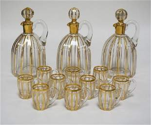 SET OF BLOWN CRYSTAL DECANTERS WITH 10 CORDIAL MUGS.
