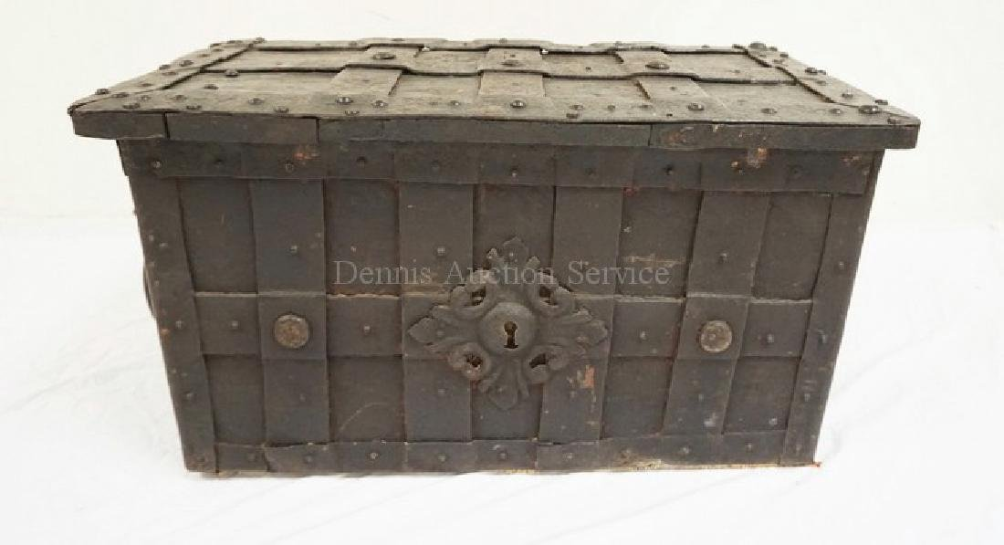 ANTIQUE STRONG BOX HEAVILY COVERED IN IRON STRAPPING