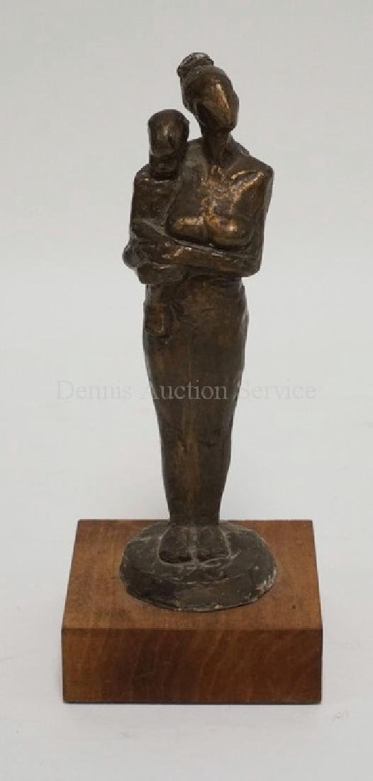 BRONZE SCULPTURE OF A WOMAN CARRYING A CHILD. 8 1/2 INC