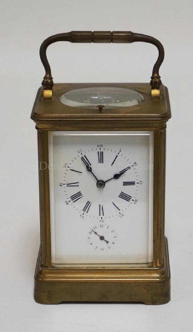 ANTIQUE BRASS CARRIAGE CLOCK WITH BEVELED GLASS PANELS
