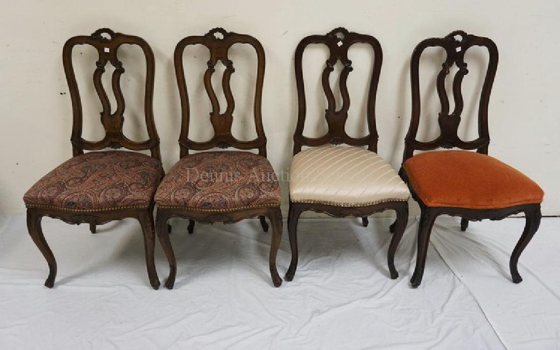 SET OF 4 CARVED WALNUT CHAIRS. EACH WITH DIFFERENT