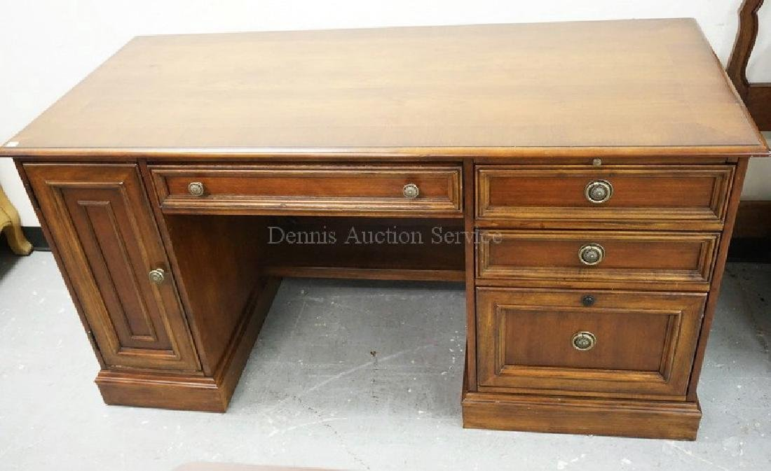 KNEEHOLE DESK MEASURING 60 INCHES WIDE. 31 INCHES HIGH.