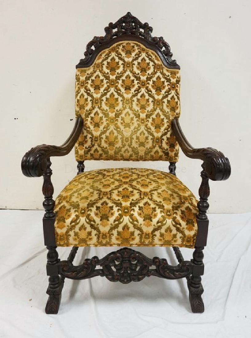 OVERSIZED CARVED WALNUT ARMCHAIR WITH A CARVED