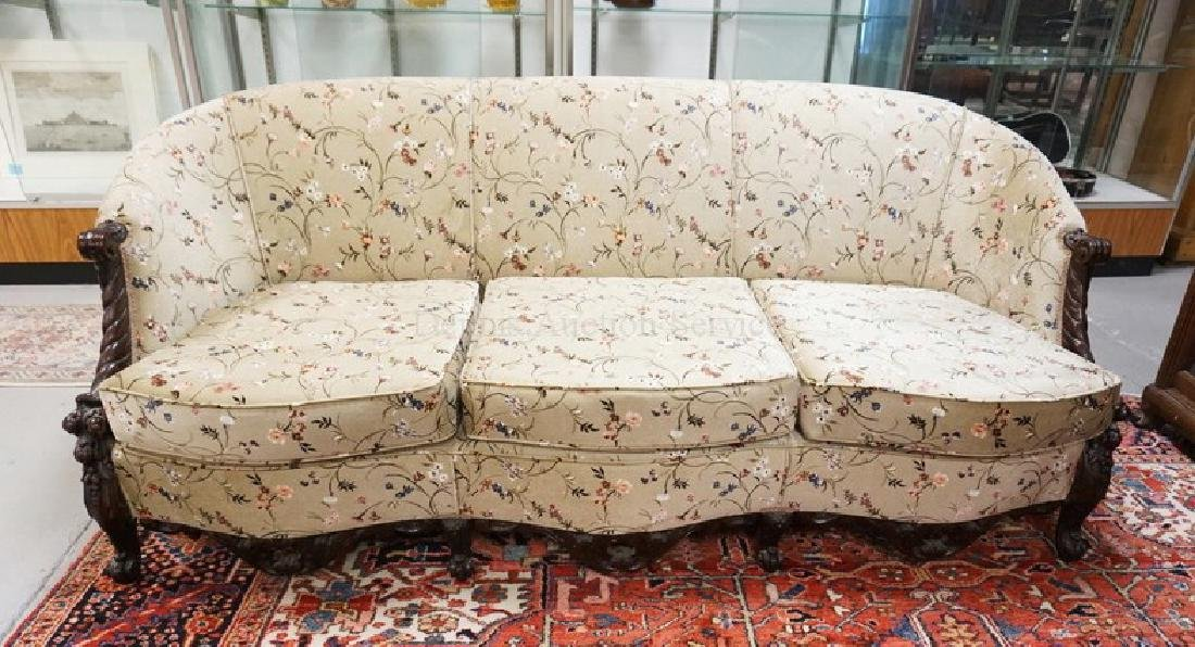ORNATELY CARVED WALNUT SOFA WITH FLORAL UPHOLSTERY. 33