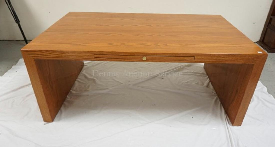 MODERN OAK TABLE. PULL OUT SURFACE. 50 X 30 INCH TOP.