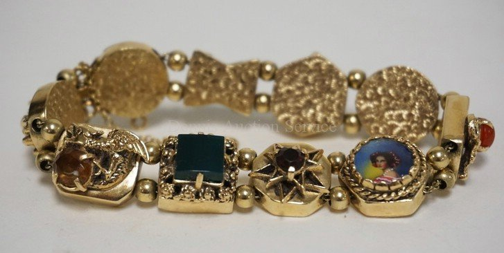 14K GOLD BRACELET WITH VARYING STONES AND FIGURED LINKS