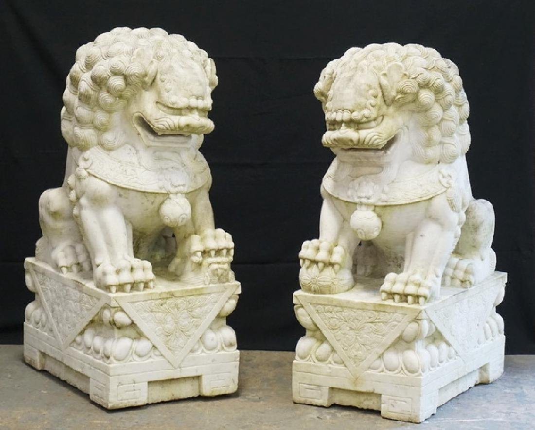 EXCEPTIONAL PAIR OF MASSIVE AND FINELY CARVED MARBLE