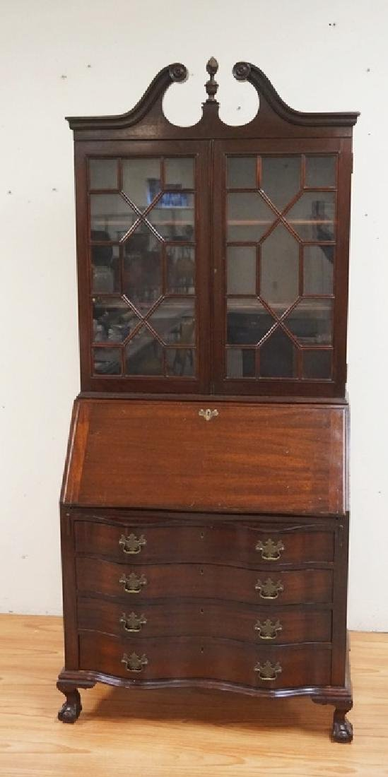 MAHOGANY SECRETARY DESK WITH A SERPENTINE FRONT AND