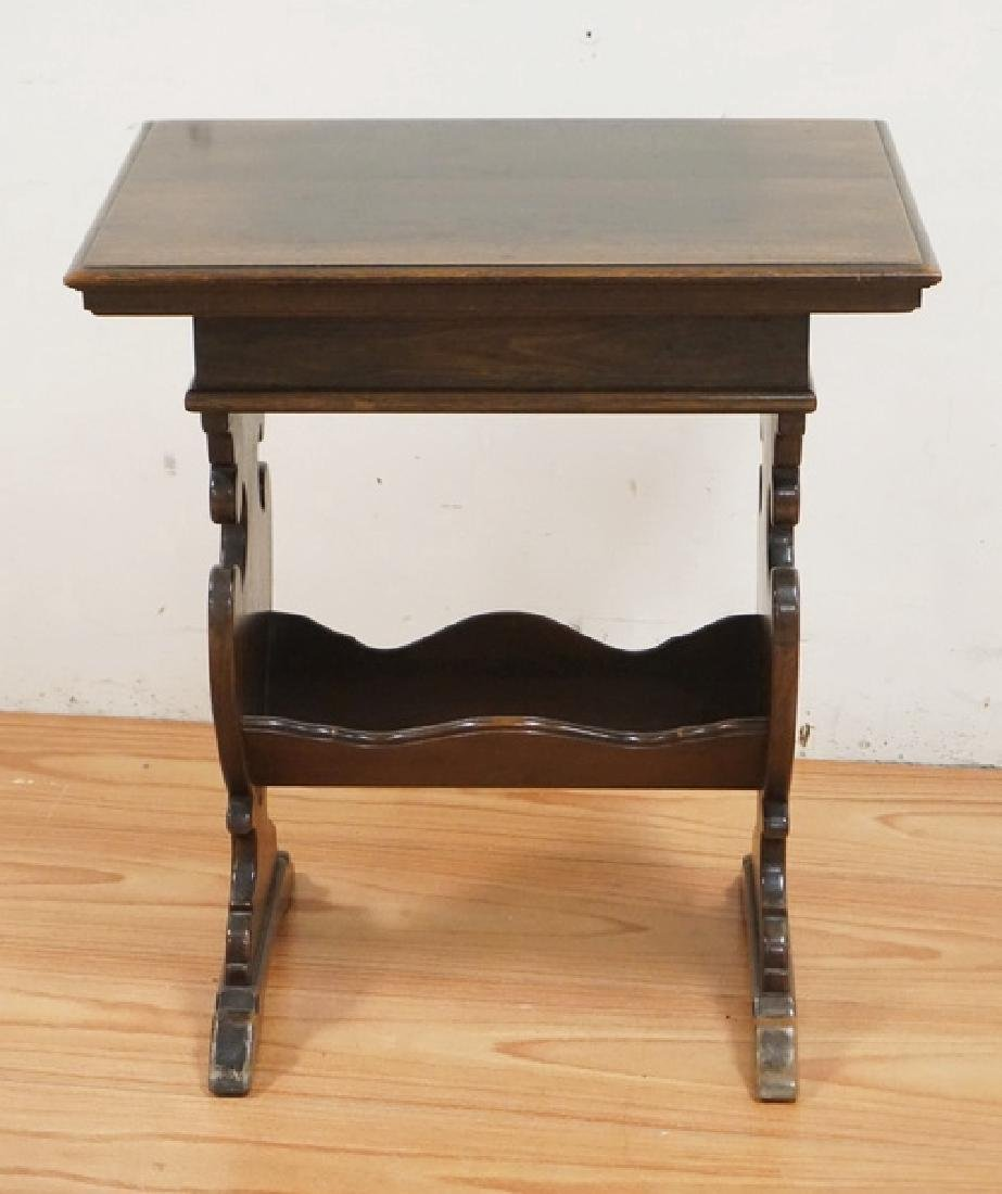 KITTINGER CARVED WALNUT TABLE WITH FLOWER FORM CARVINGS